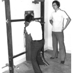 Ip Chun teaching Sam Kwok Dummy Form.jpg