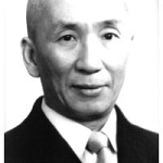 Ip Man in a suit fadded.jpg