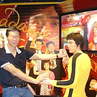 Samuel Kwok and a wax work for Bruce Lee on the way up to the peak