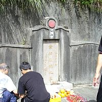 Sam Kwok and Ip Ching pay respects at Ip Man's grave in Fan Ling Hong Kong